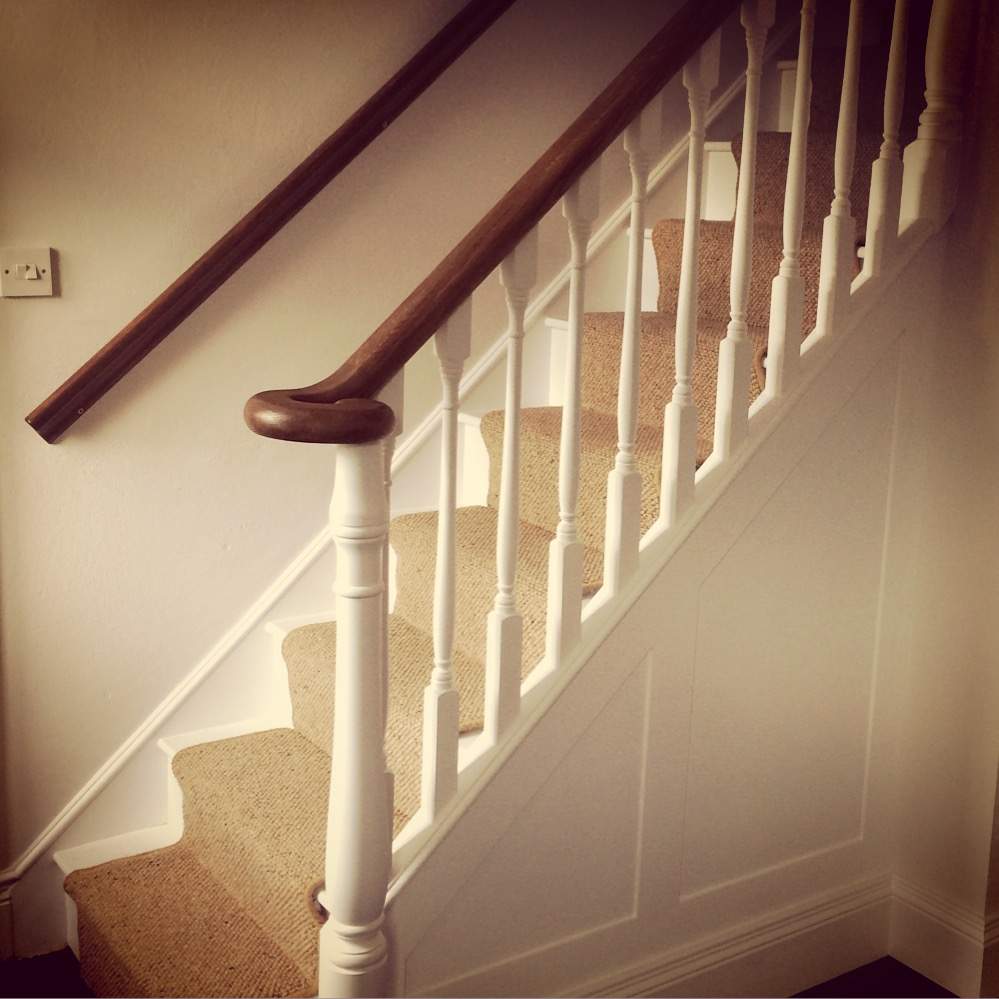 Walnut newel with white painted spindles